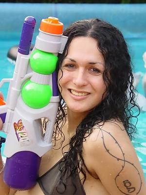 Amazing Tranny Nikki posing in the pool