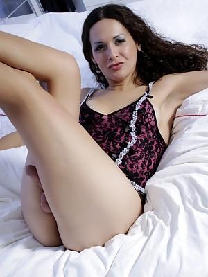Glamorous Nicole Montero posing on the bed